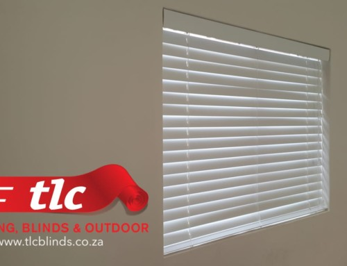 A Recently Decorated Room With White Venetian Blinds